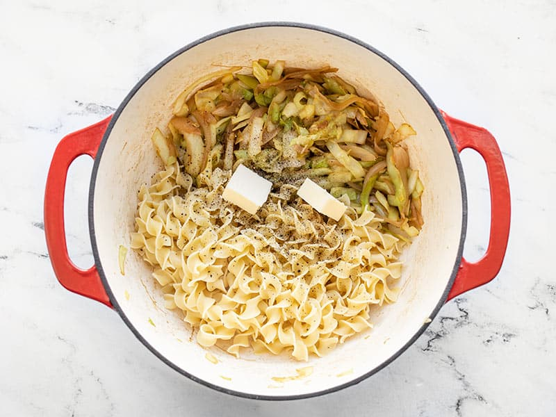 Cooked noodles, butter, and cabbage in the pot