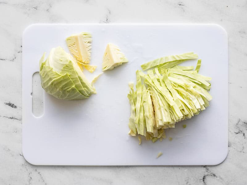 Sliced green cabbage on a cutting board