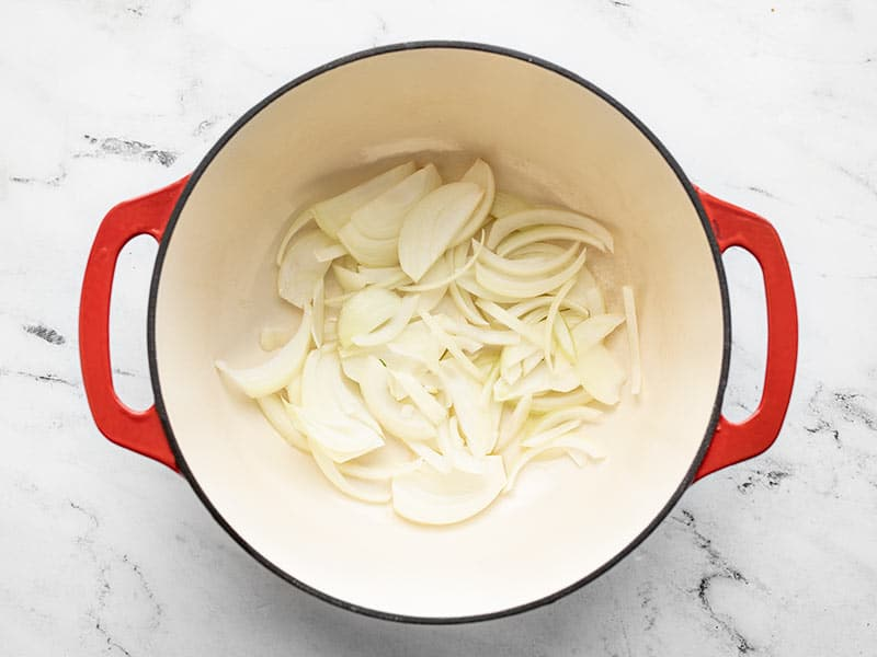 Sliced onions in large pot