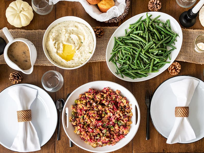 Thanksgiving side dishes on a table from above