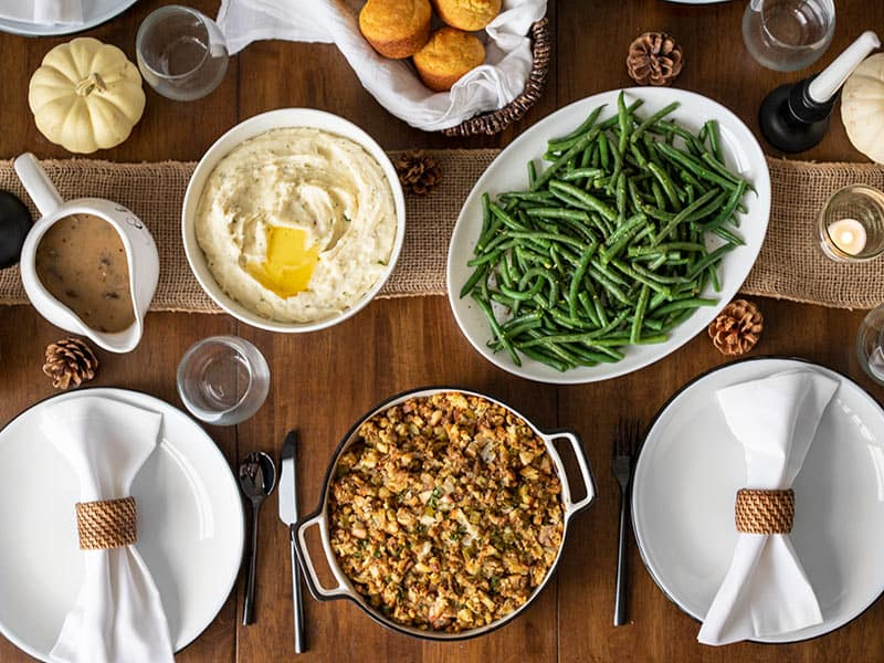 Overhead view of a table full of Thanksgiving side dishes
