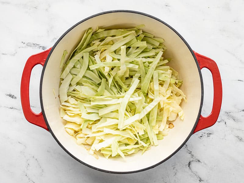 Add sliced cabbage to the large pot
