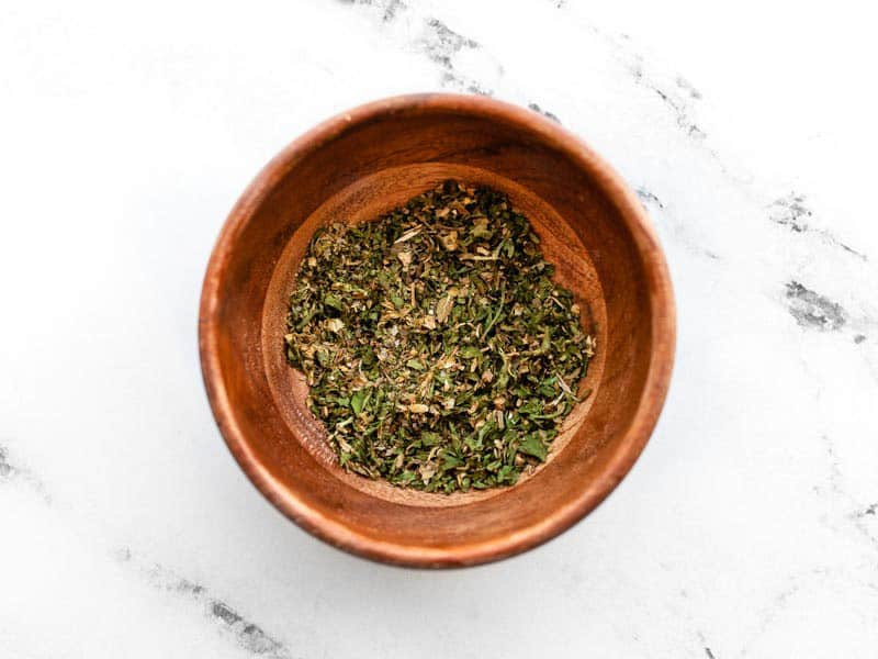 all-purpose garlic herb seasoning in a small wooden bowl