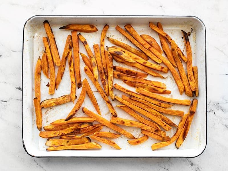 Baked sweet potato fries on the baking sheet