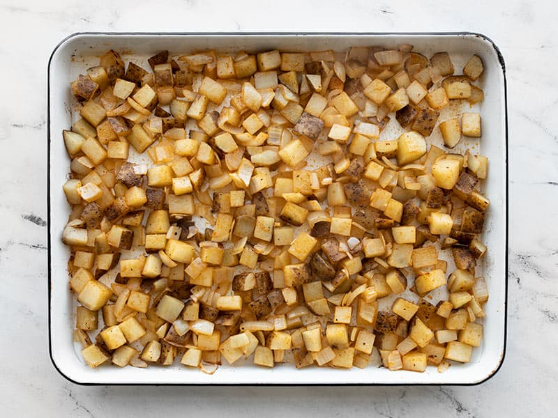 Potatoes and onions after roasting 20 minutes