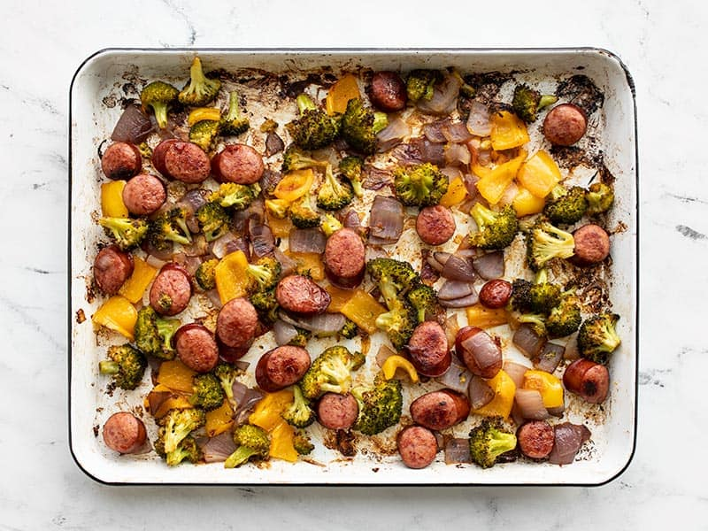 Roasted sausage and vegetables on the baking sheet