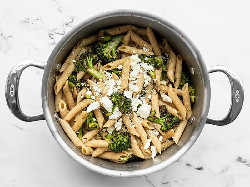 Feta added to pasta in the pot