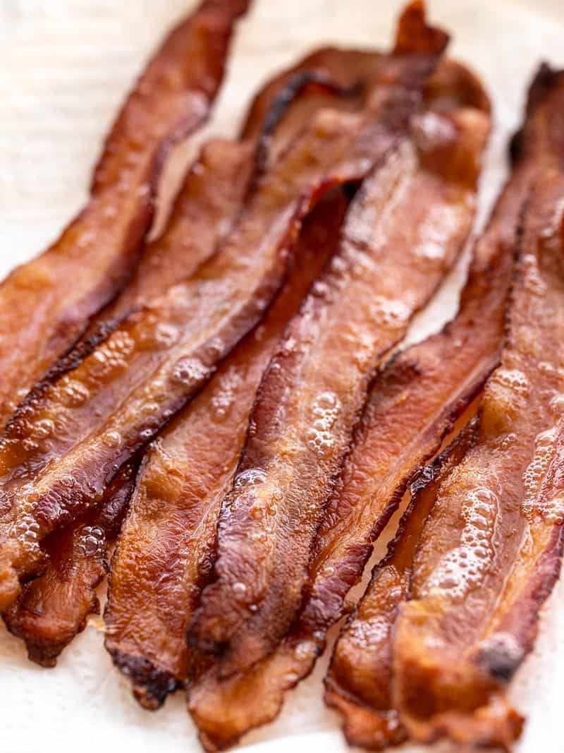 Strips of hot bacon piled on a plate