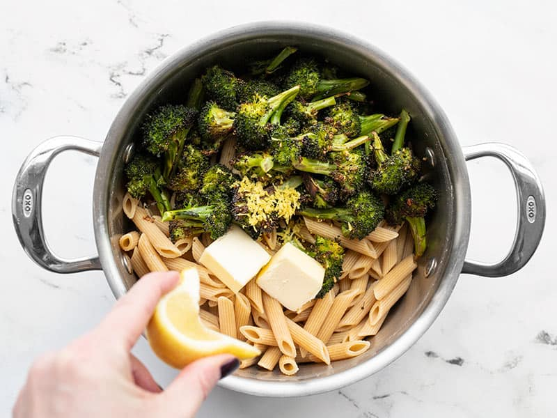 Pasta, broccoli, butter, and lemon combined in the pot.