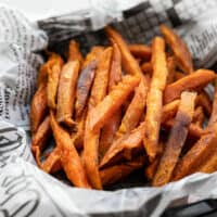 Close up side view of one bowl full of spicy sweet potato fries