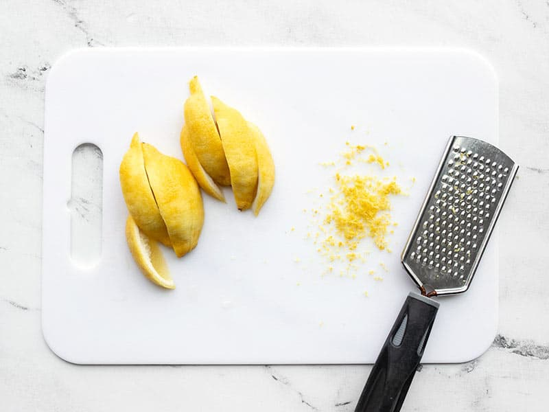 Zested and sliced lemon