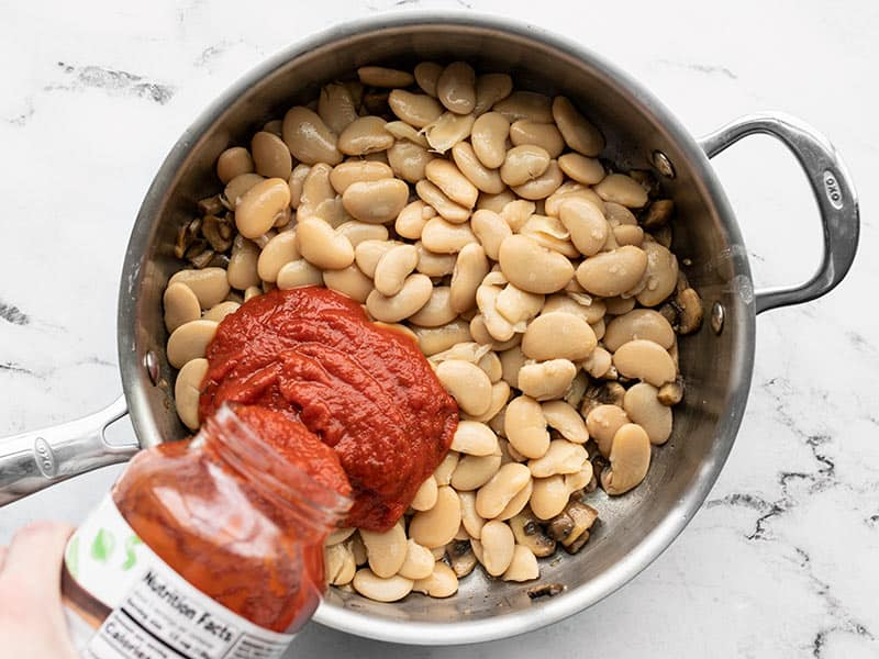 Add beans and marinara to the skillet