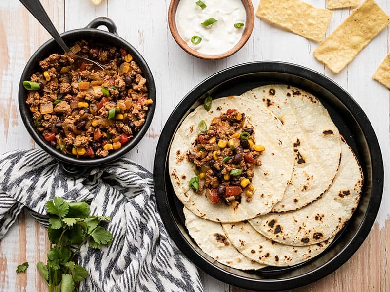 Turkey Taco Skillet served with toasted tortillas and sour cream