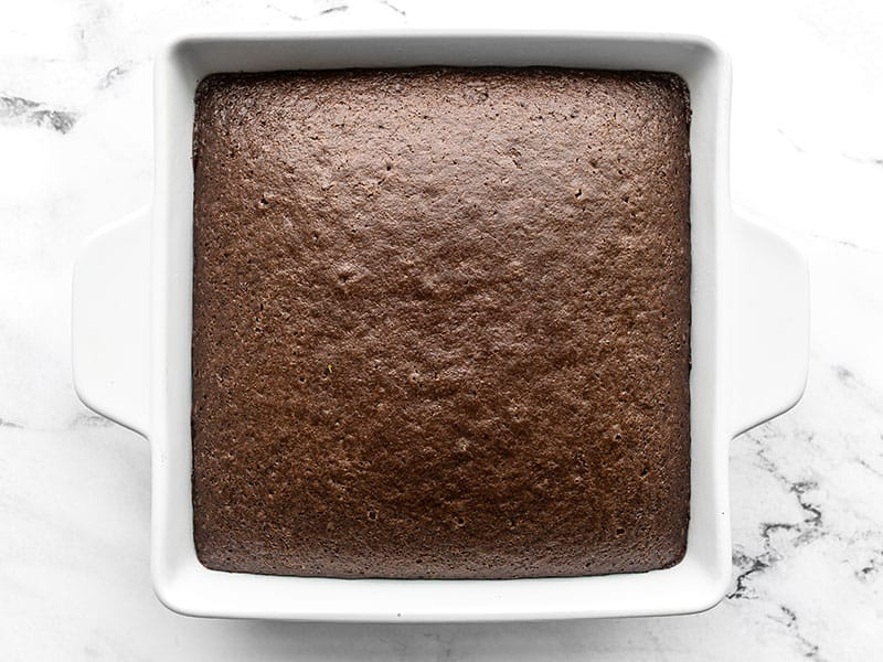 baked chocolate cake in the white square baking dish