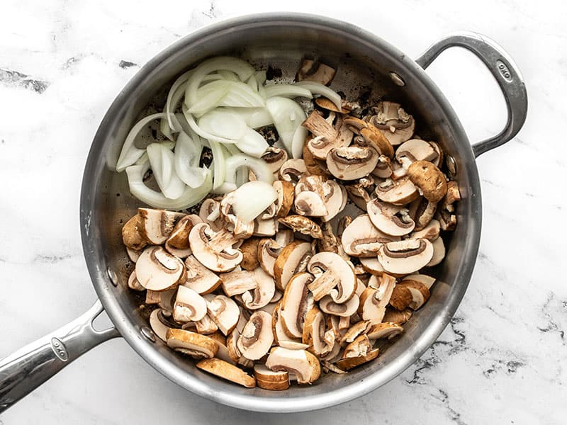 Onions and Mushrooms added to the skillet