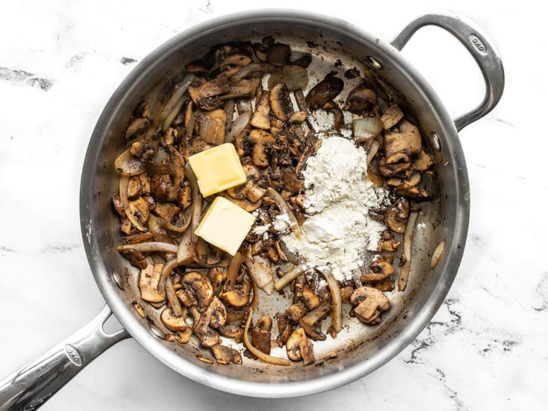 Butter and flour added to the skillet with the mushrooms and onions.