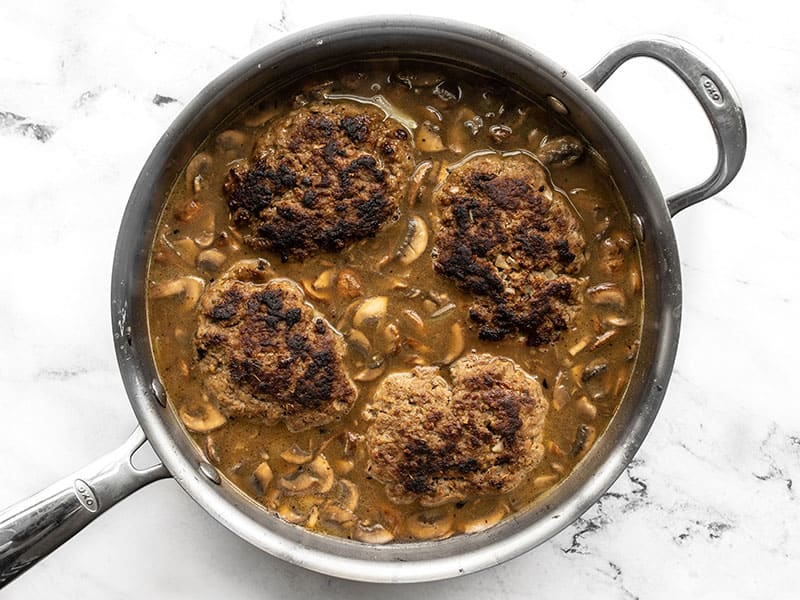 Beef patties returned to gravy in the skillet