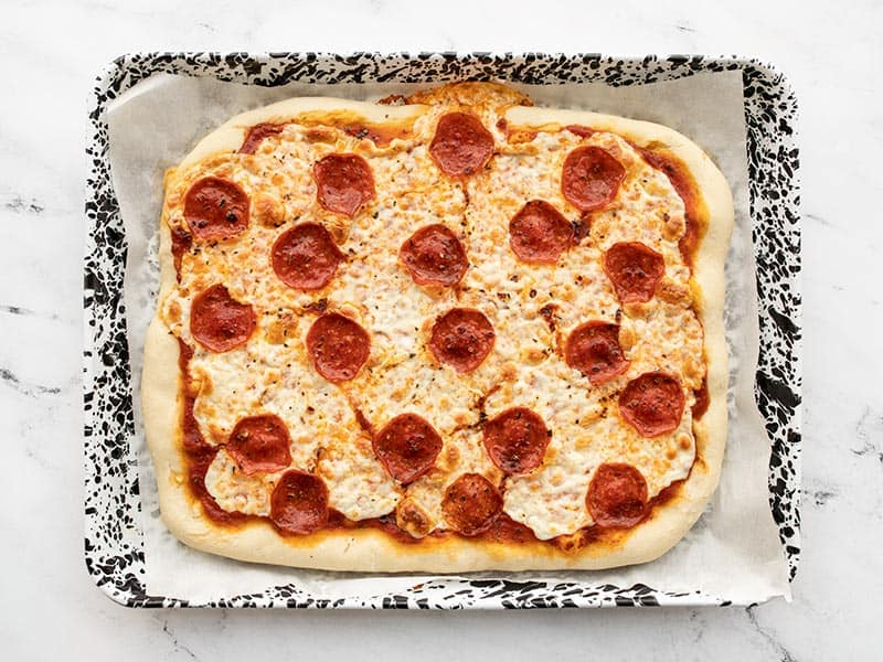 Baked pepperoni pizza on sheet pan
