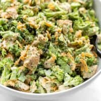 Close up side view of a bowl of Broccoli Cheddar Chicken Salad