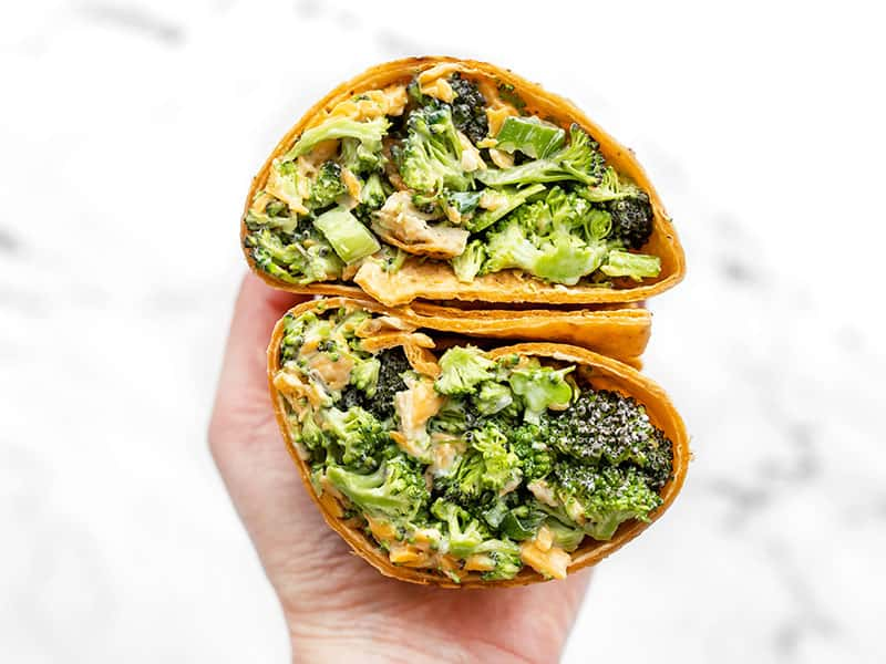 Broccoli Cheddar Chicken Salad in a wrap sandwich, open and facing the camera close up