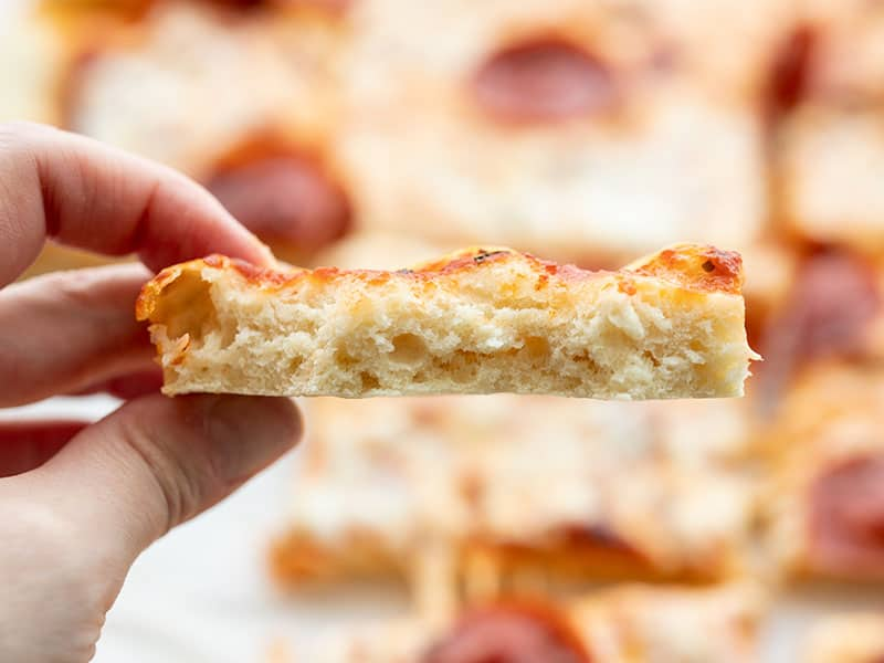 Inside look at a piece of no yeast pizza crust