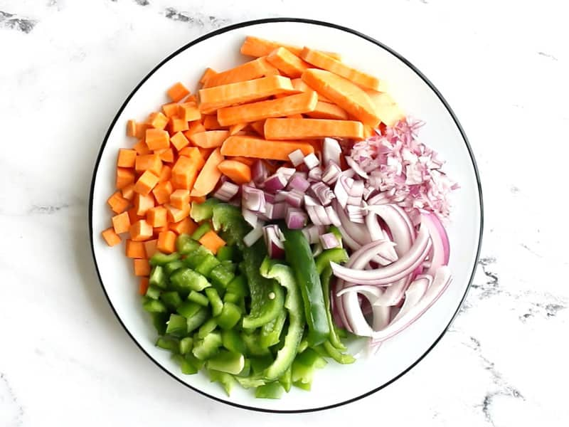 Sliced, diced, and minced red onion, bell pepper, and sweet potato