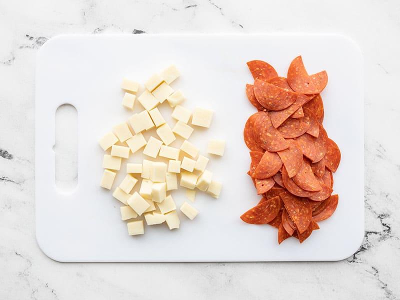 Mozzarella and pepperoni on a cutting board