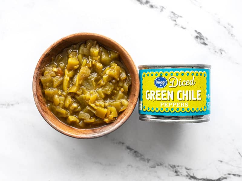 Canned green chiles in the can and in a bowl