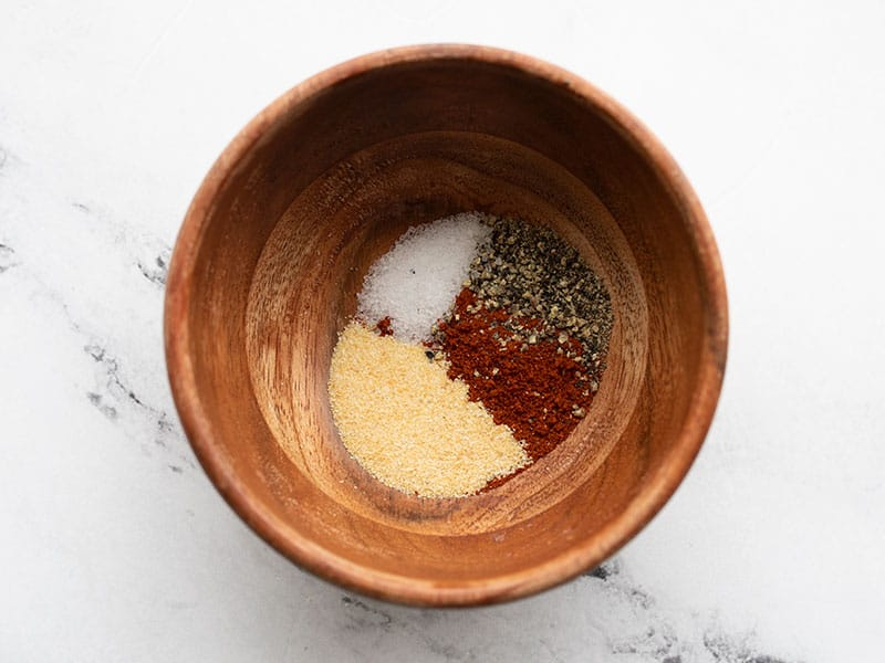 seasoning for bbq chicken in a small wooden bowl