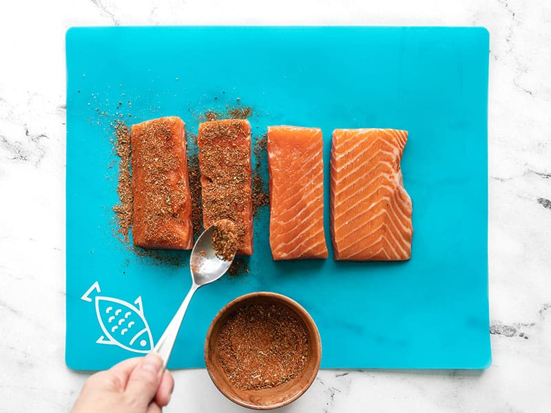 Season salmon filets