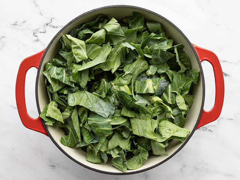 Collard greens added to the pot