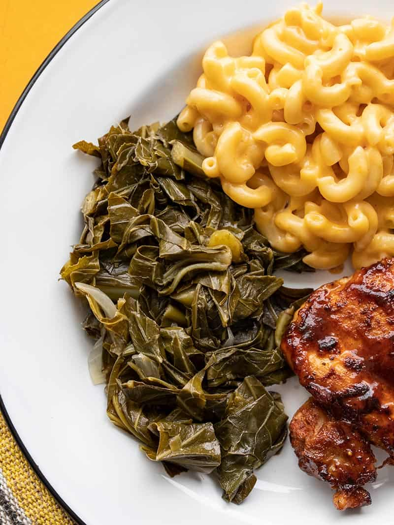 Collard Greens on a plate with Mac and Cheese and BBQ Chicken