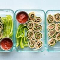 Three pizza roll up lunch boxes lined up in a row