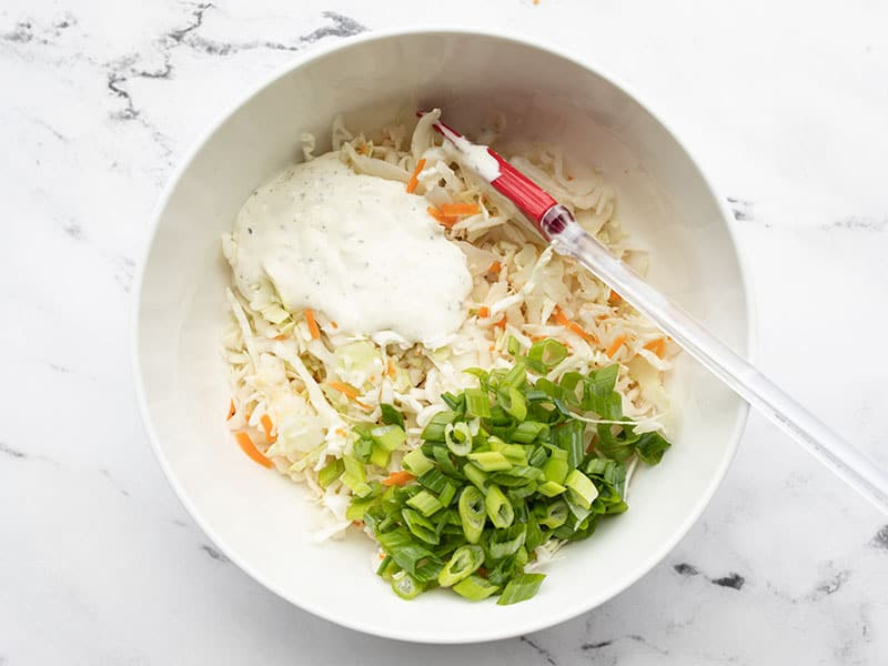 Ranch slaw ingredients in a mixing bowl