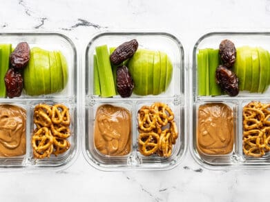 Three glass containers of the peanut butter lunch box lined up in a row