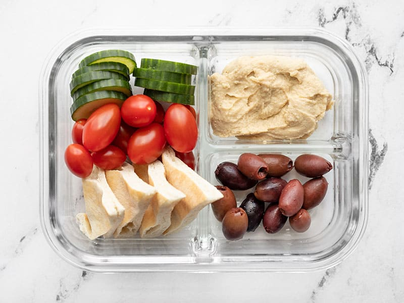 Overhead view of one hummus lunch box.
