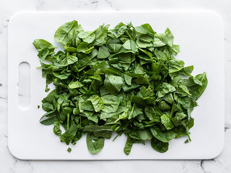 Chopped spinach on a cutting board