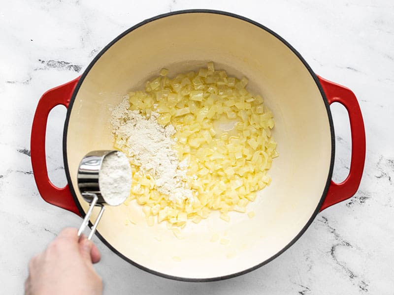 Sautéed onion and butter, flour being added to the pot