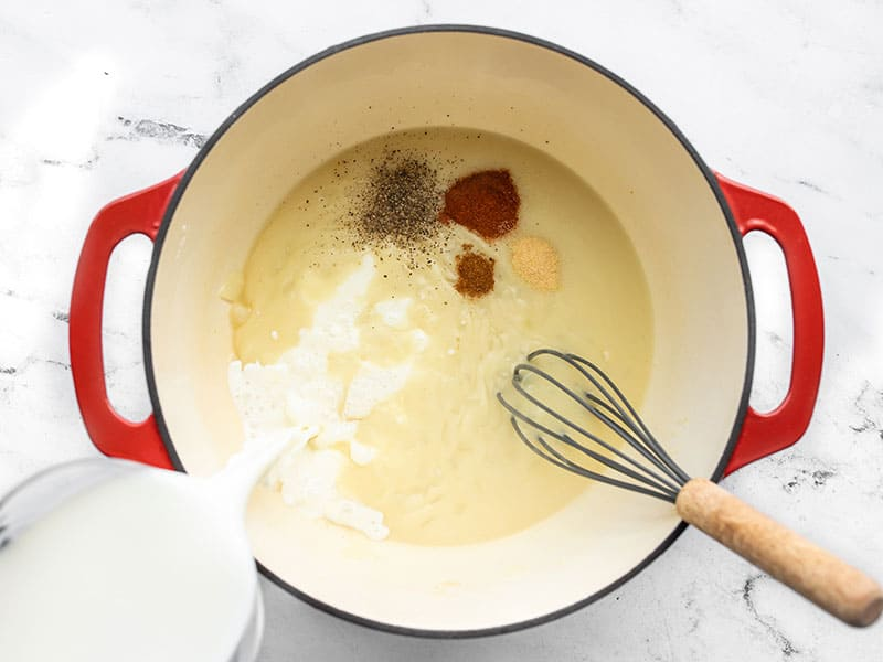 Whisk in milk and spices