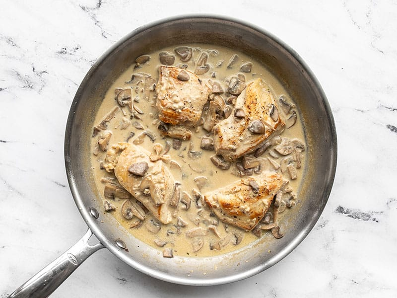 Chicken in creamy mushroom sauce in the skillet