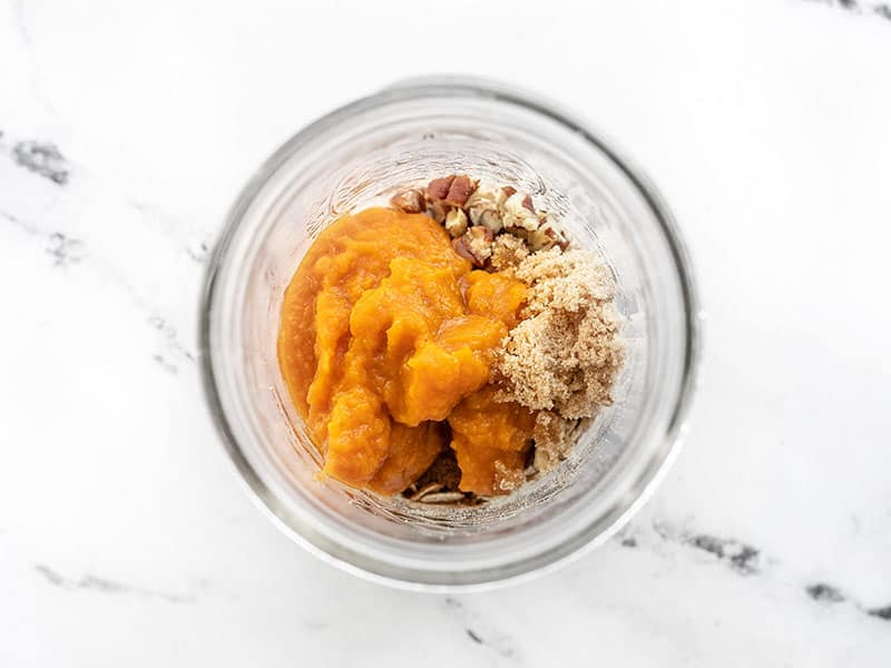 pumpkin puree and brown sugar added to the jar