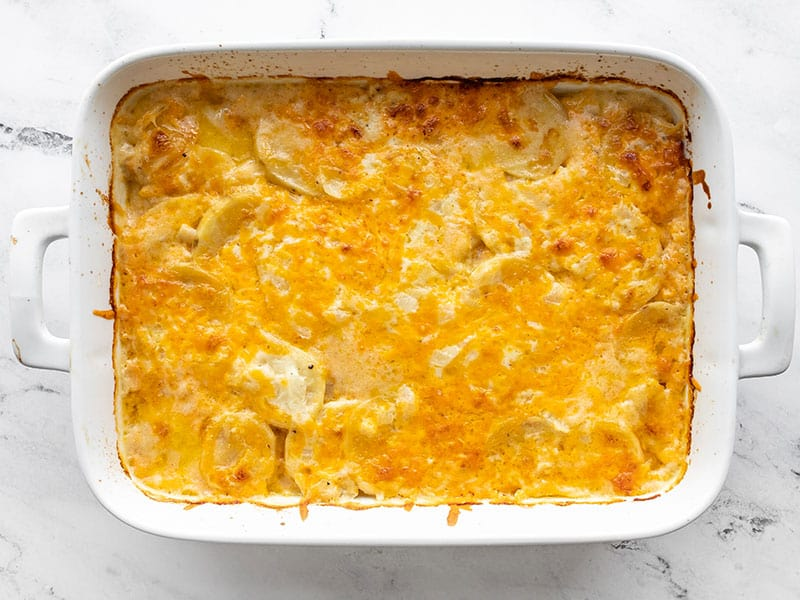 Baked potatoes au gratin in the casserole dish
