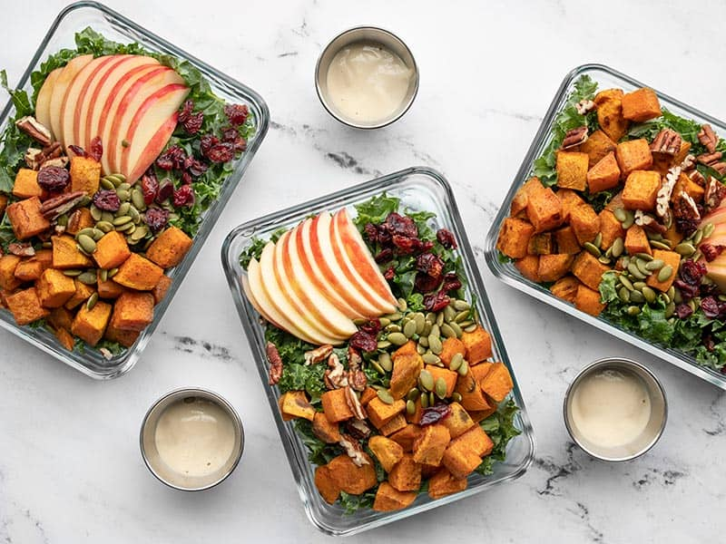 meal prep containers full of autumn kale and sweet potato salad