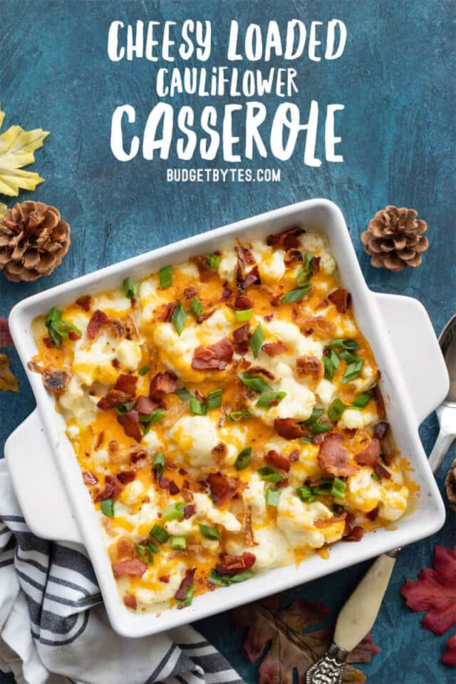 Overhead view of cheesy loaded cauliflower casserole with title text at the top