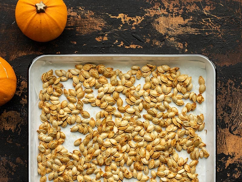 Roasted pumpkin seeds on a baking sheet