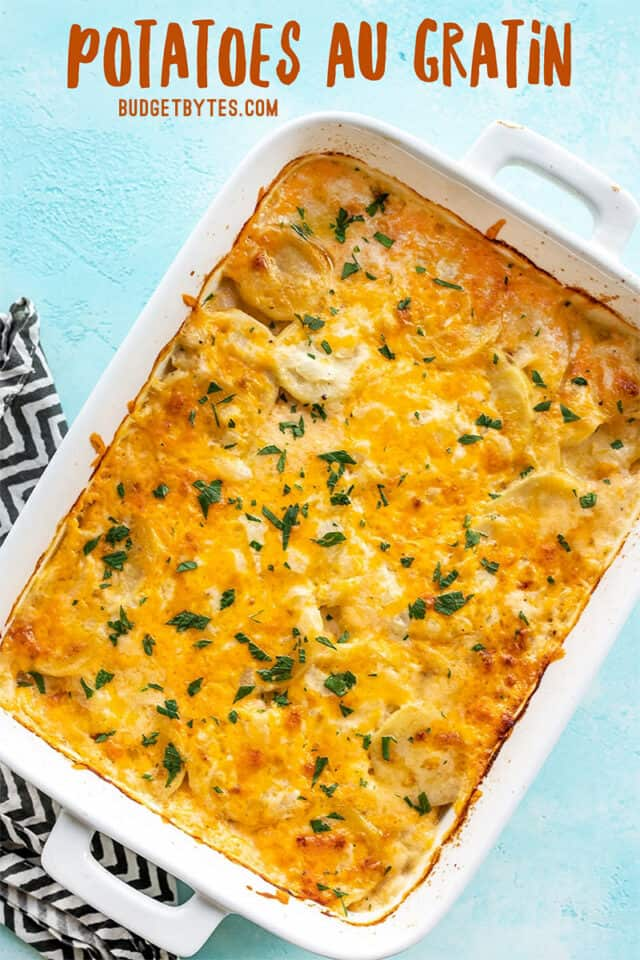 Overhead view of potatoes au gratin with title text at the top