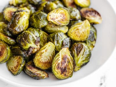 Close up side view of Roasted Brussels Sprouts in a bowl