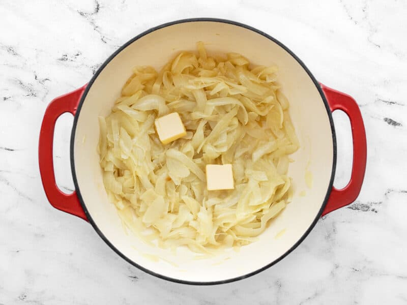 Add butter to golden onions in the soup pot