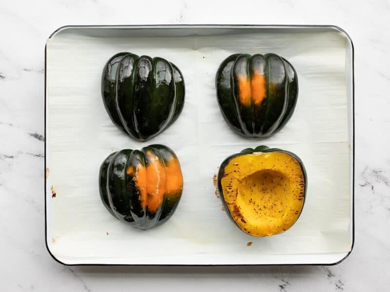 roasted acorn squash on the baking sheet
