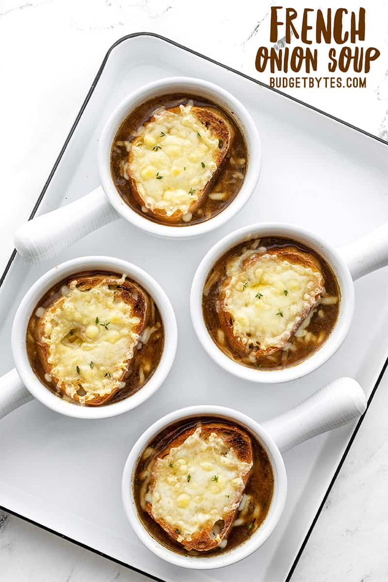 Four bowls of french onion soup on a tray, title text at the top